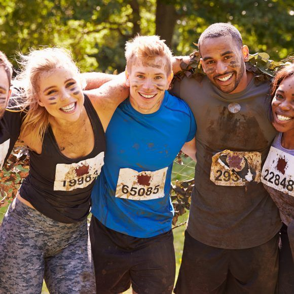 Competitors celebrate completing an extreme endurance event